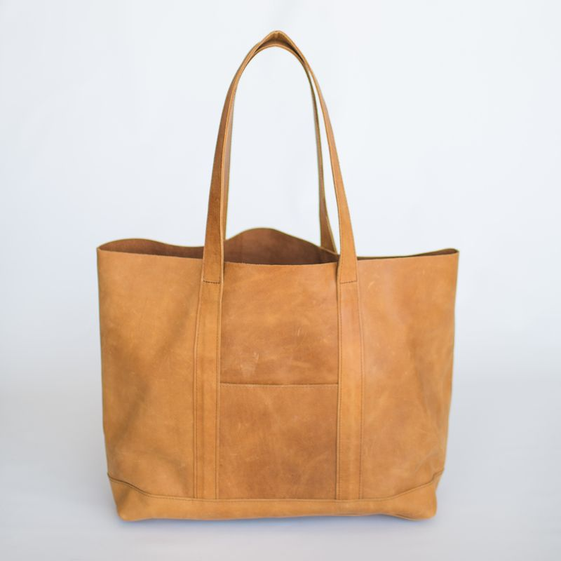 ed30da2ea376 Addis Tote  Leather Shoulder Bag For Fall Fashion. Handmade in Ethiopia.  Large enough to carry your laptop. Seen here in camel