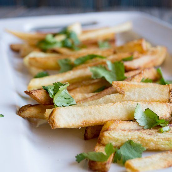 Crispy, golden french fries topped with lime zest, salt, and ...