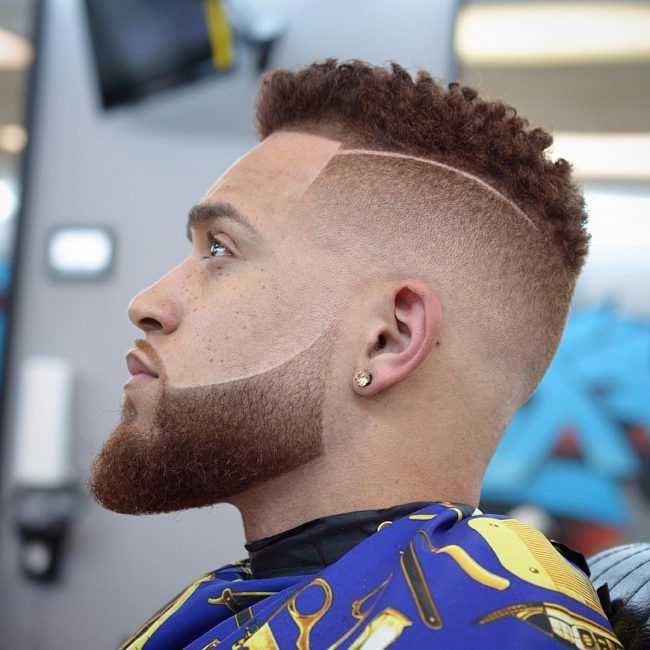 curly fade with side part barber