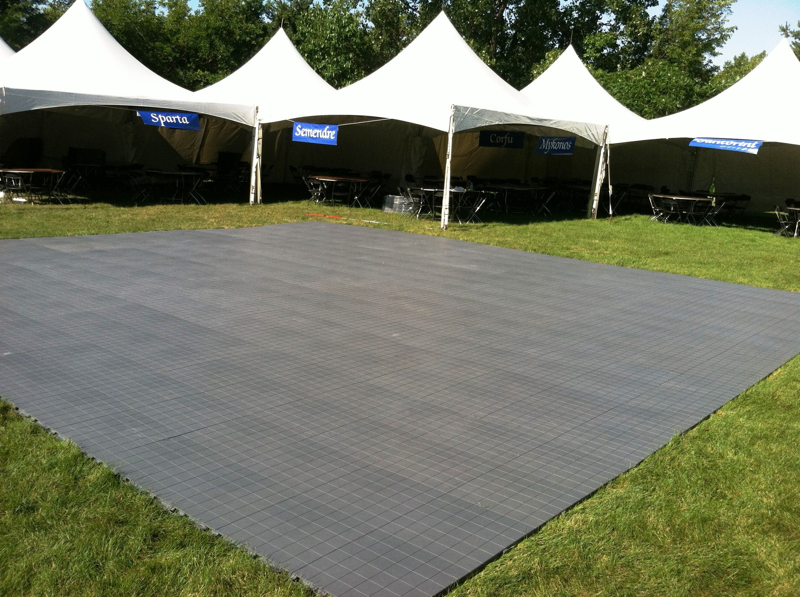 A festival with 12 festival frame tents and event flooring