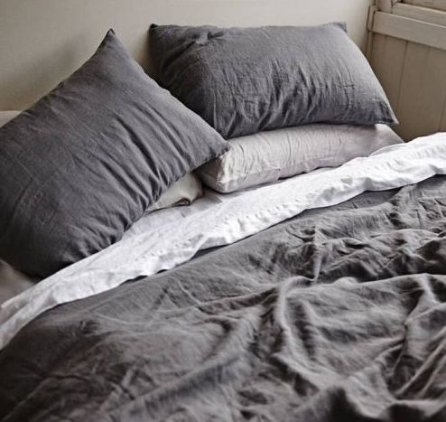 Photo of bed with grey sheets