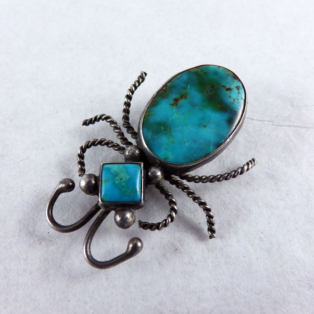 Our favorite Blue Gem turquoise is set in sterling silver in this old Navajo Indian bug pin.