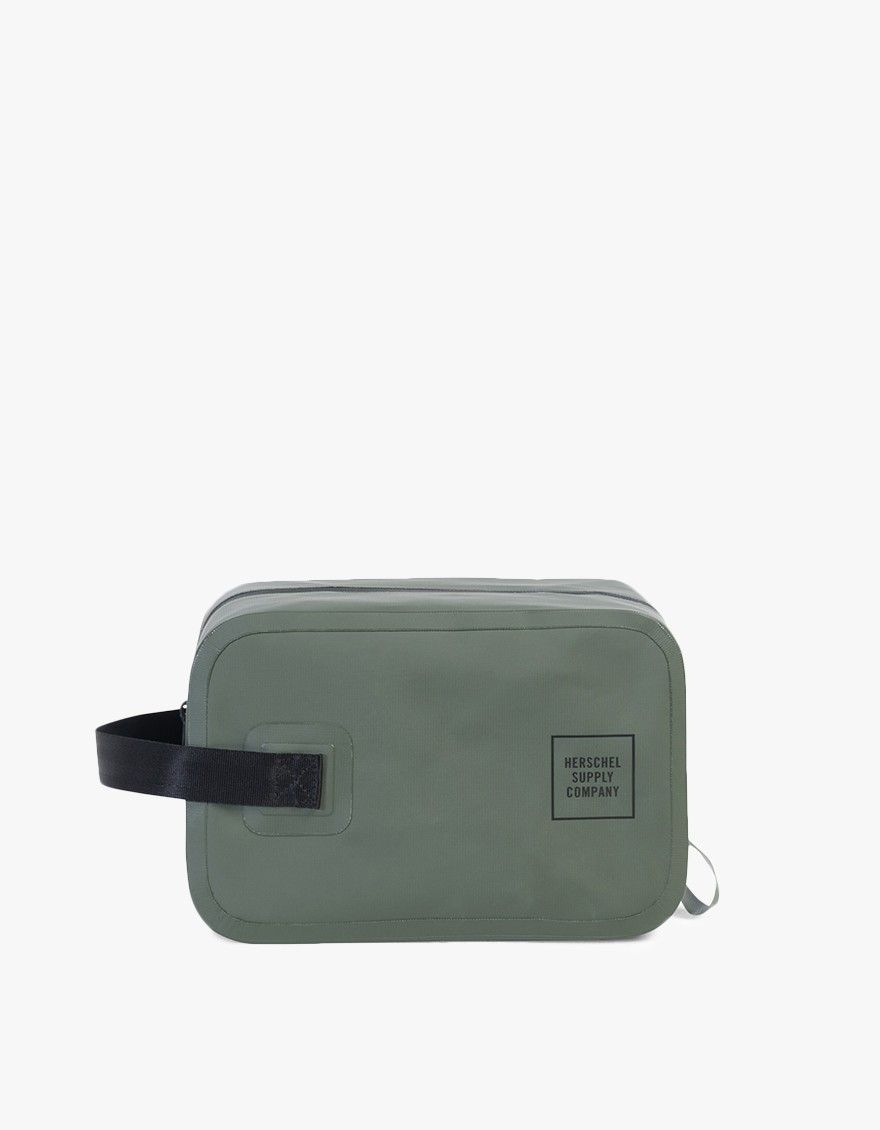 c8b0f383b1b2 Dopp kit from Herschel Studio in Vineyard Green. Waterproof top zip  closure. Seatbelt webbing handle. Die-cut carrying loop. Screen printed  logo detailing ...