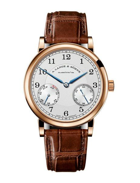 A. LANGE & SÖHNE 1815 UP/DOWN WATCH (Men) • The classic style of the 1815 Up/Down pays homage to A. Lange & Söhne's celebrated pocket watches. With an 18K-rose-gold case and silver dial, the face receives an extra pop of color from blue steel hands. $27,400.