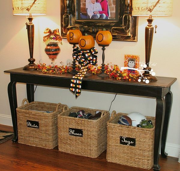 foyer table with storage. love the decor for halloween but storage baskets underneath even more! foyer table with a