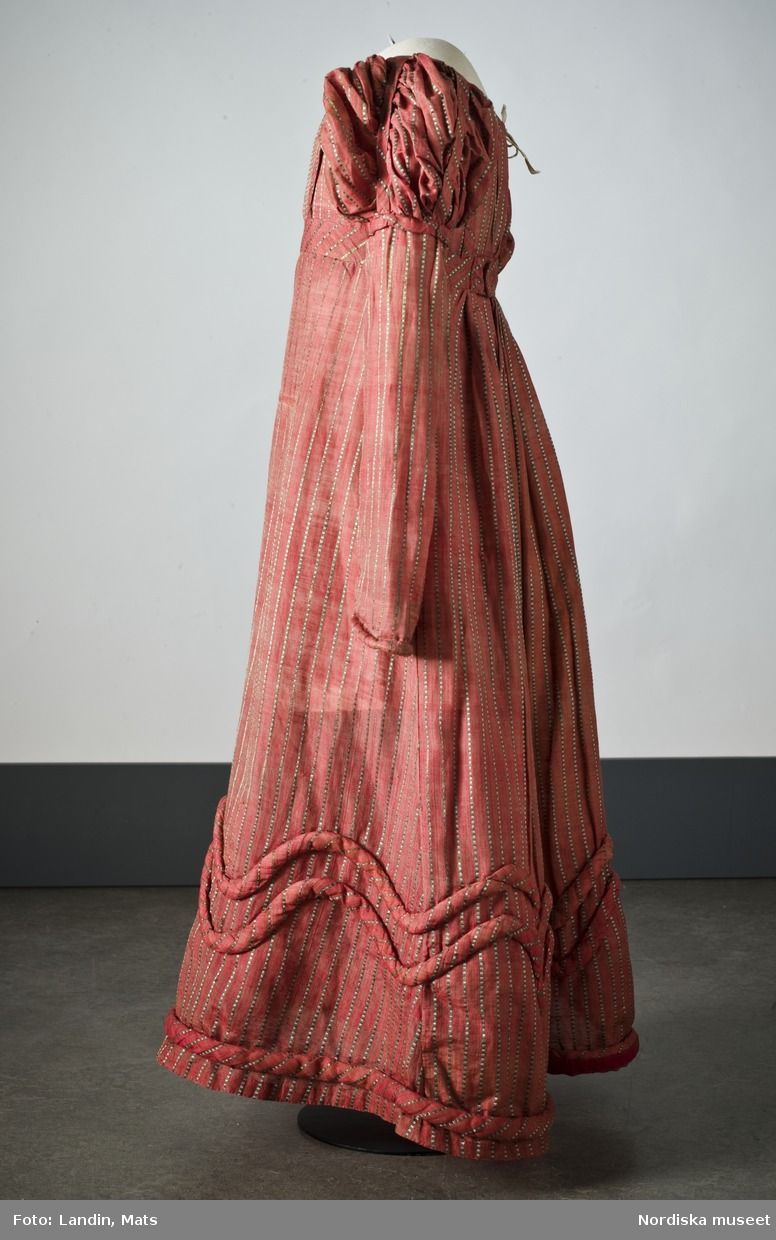 Dress of pink-colored silk with stripes in gray and green silk. The ...