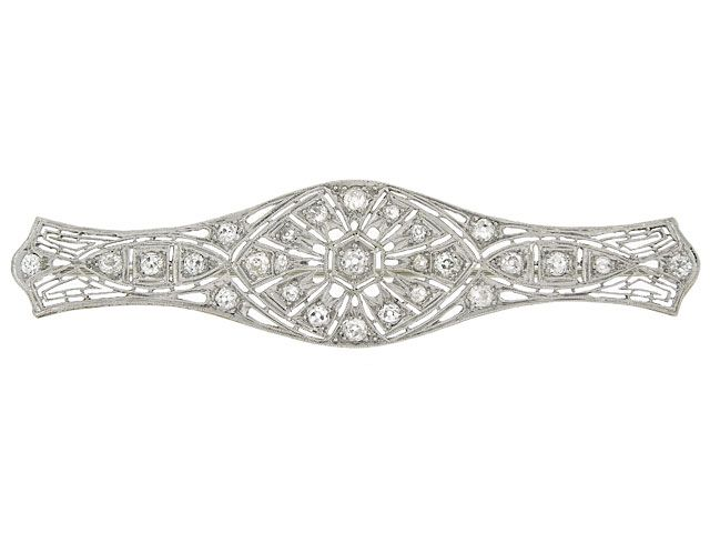A Turn of the Century treat, this Edwardian diamond bar brooch is a lacy accessory that you will love! The intricate, openwork brooch is cra...