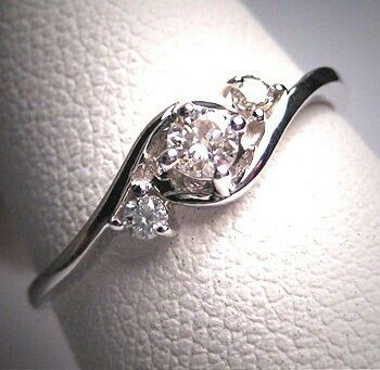 Diamond ring. Reminds me of my Grammy's ring!