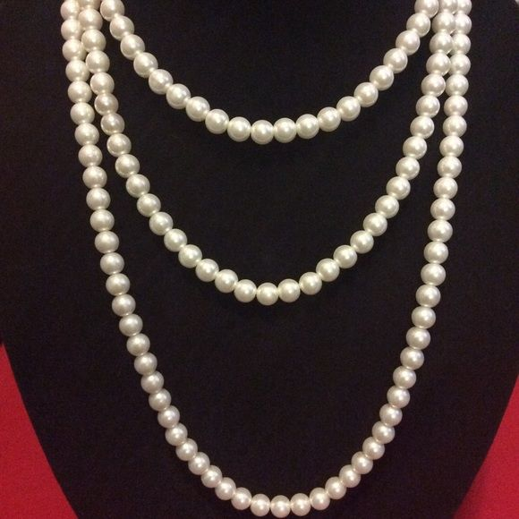 """NEW UNUSED 60"""" glass beaded pearl white necklace New ICING's 60"""" glass beaded pearl white necklace can be worn in multiple styles, including as a belt. ICING Jewelry Necklaces"""