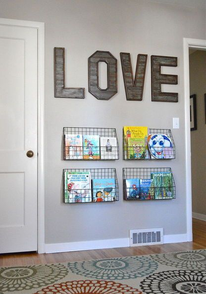 Baskets On A Wall Can Serve The Same Function As Bookshelf Or Be Staging Area For Library Books