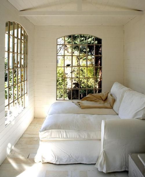 Great use of a small space.  I want to curl up in this comfy sunroom!