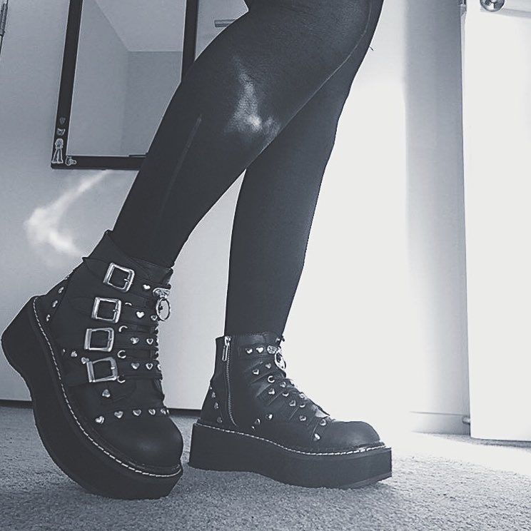 """9d0205ef3 The combat boot for when you mean business, but you're a hopeless romantic  at heart, the 2"""" platform #Demonia Emily-315 lace-up ankle boot…"""