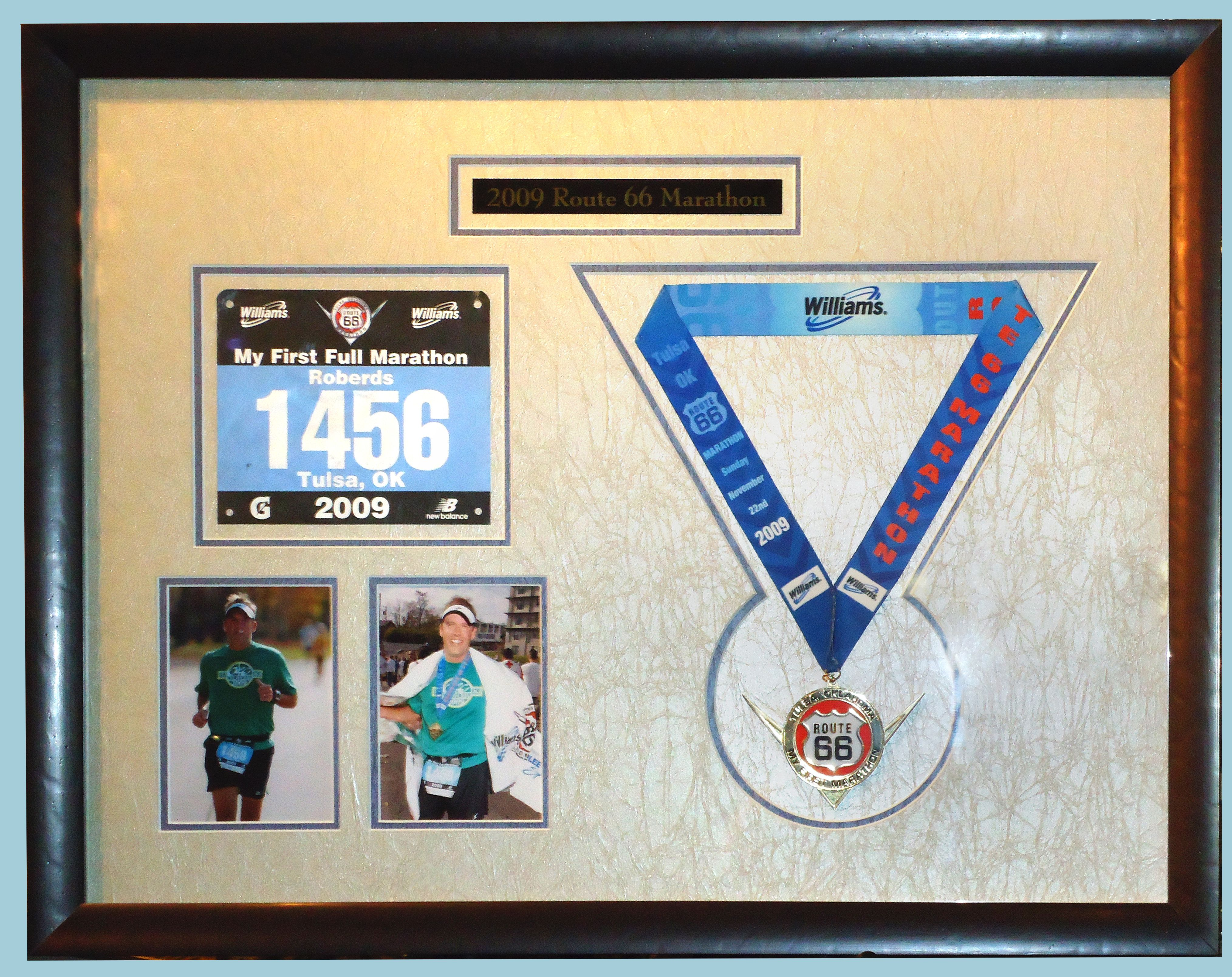 This customized display of race medal, race tag, and photos are a ...