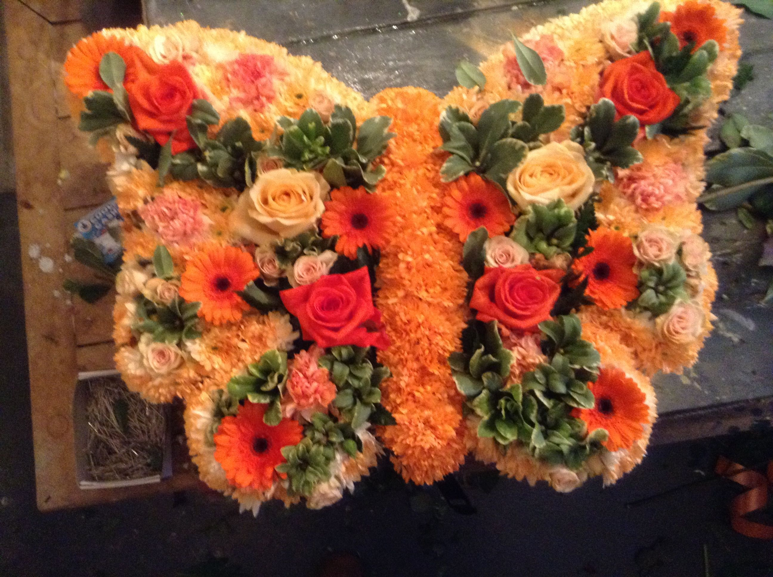 Funeral flowers orange butterfly funeral flower tribute bespoke funeral flowers orange butterfly funeral flower tribute bespoke funeral flowers unusual funeral flowers izmirmasajfo Image collections