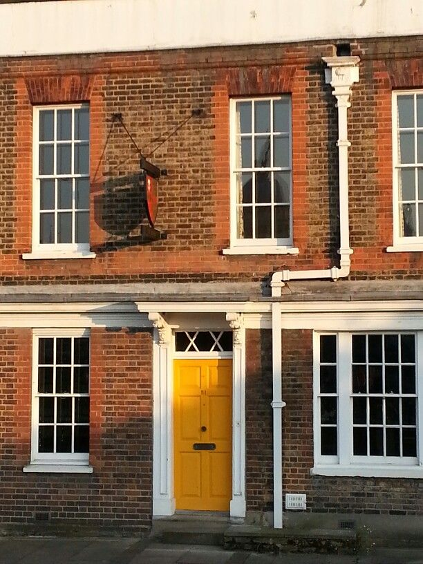 Red brick house with a bright yellow door love love - Brick house front door ...