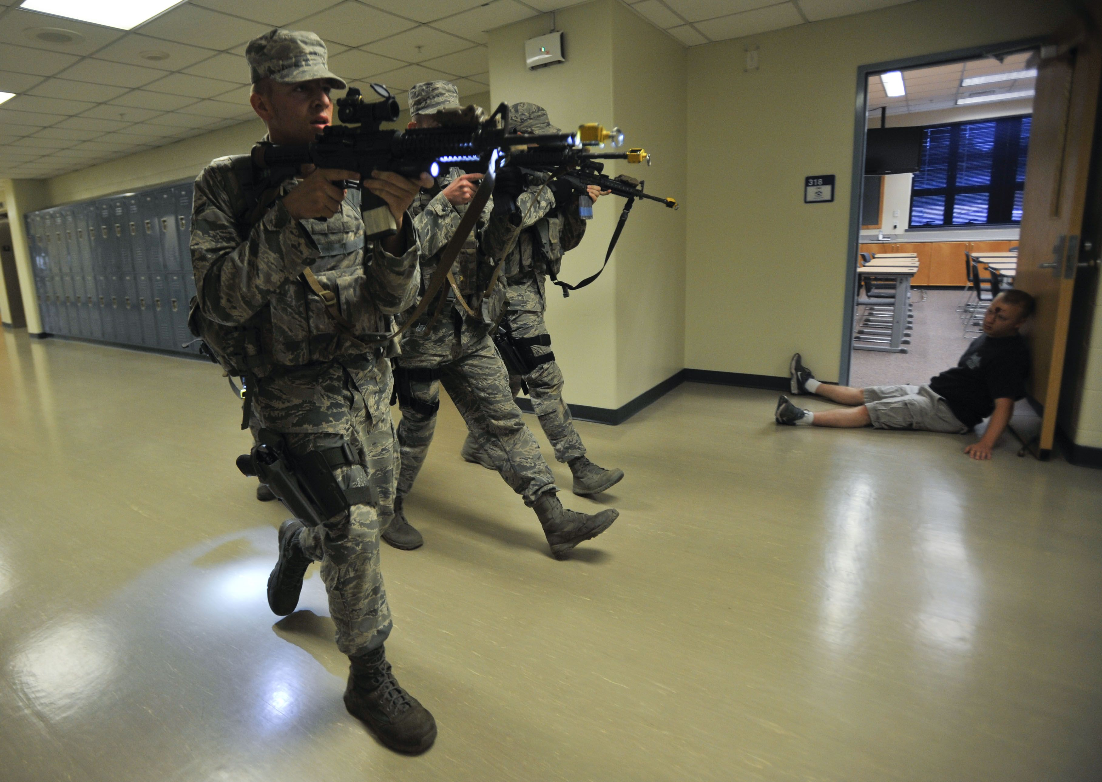 Members Of The 51st Security Forces Squadron Search An Osan Middle School Hallway In Pursuit Of The Active Shooter During A Co Airman Air Force School Hallways
