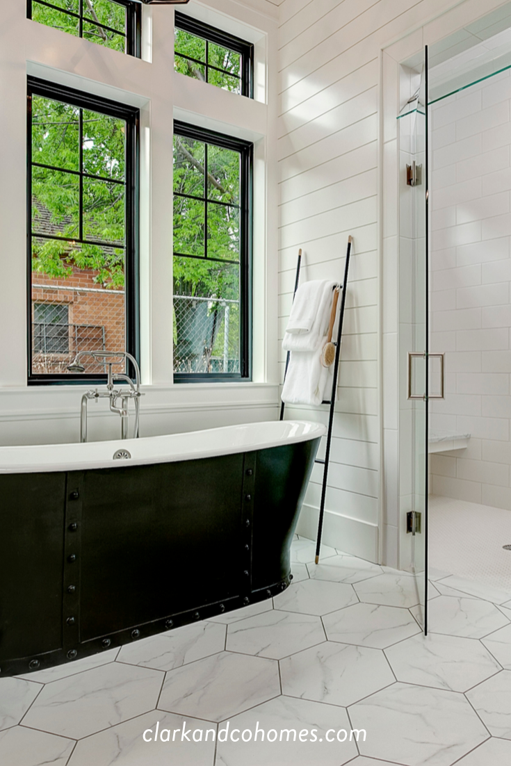 Back Windows And A Vintage Inspired Freestanding Tub Contrast With The White Hexagon Tile F White Hexagon Tile Bathroom White Master Bathroom Free Standing Tub