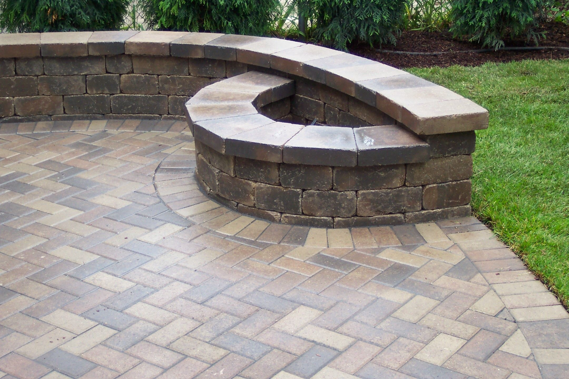 brick patio with fire pit London Stoneworks LLC