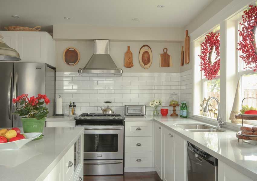 Kitchen Styling and Why I love HomeSense - Maria Killam - Colour Expert #howtodisguiseyourself Kitchen decorating ideas. How to disguise your bulk head above upper cabinets. Decorating with red. #howtodisguiseyourself
