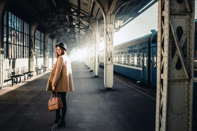 Girl in the railway station. Sun light