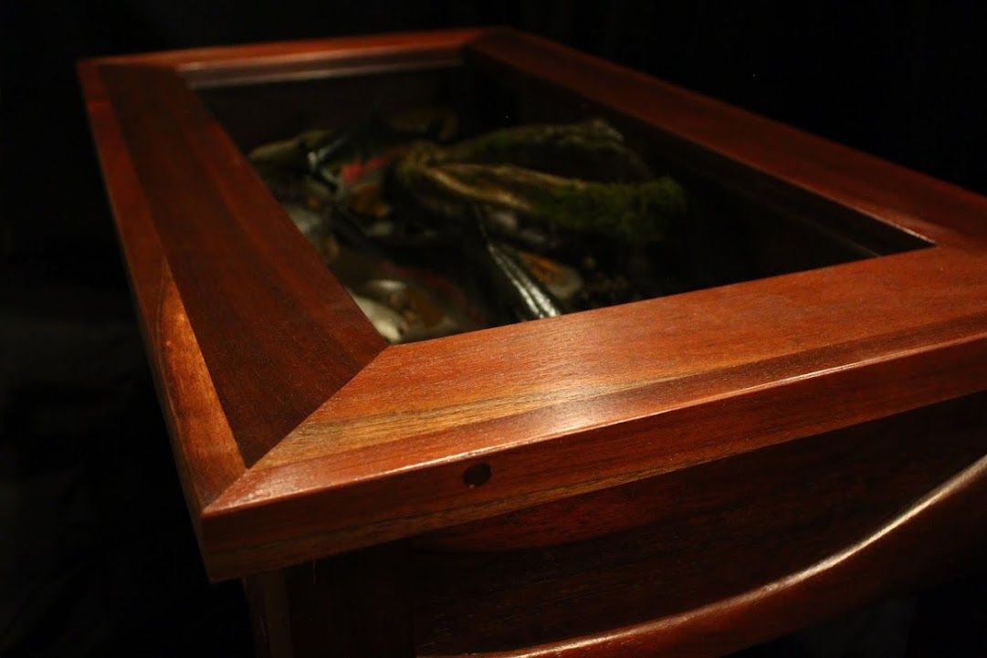 One of my favorite tables from my woodshop: Peruvian walnut with two hand-carved trout inside.