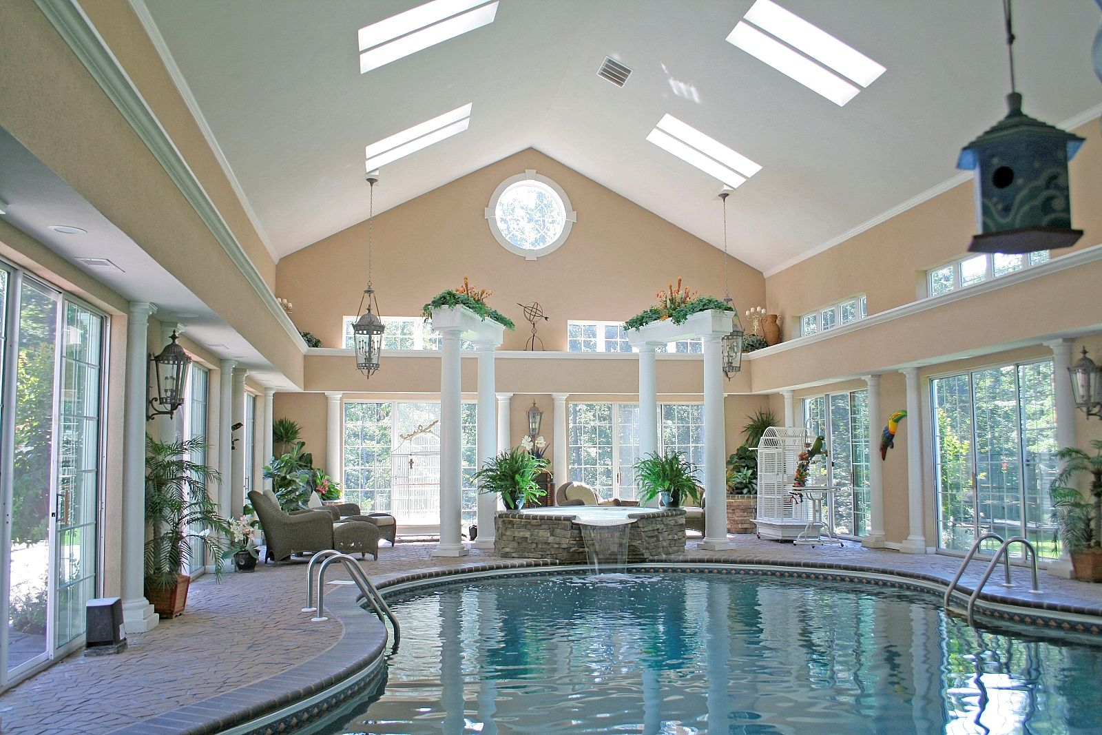 Interior splendid spacious white cream indoor pool for Fancy swimming pool designs