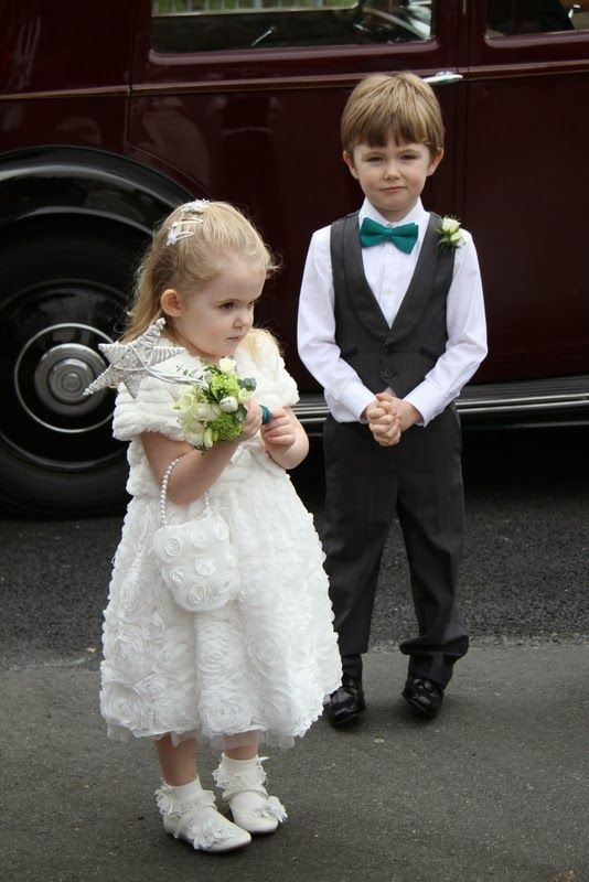 The adorable little Flower Girl carried one of our rustic Magic Wands