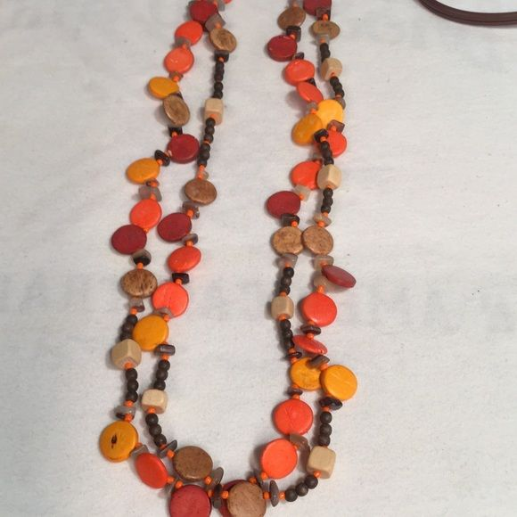 "Painted Wood Mother of pearl necklace..new New without tags ..this is shown as doubled but can be worn as one long necklace..measures 27"" length Wood Jewelry Necklaces"