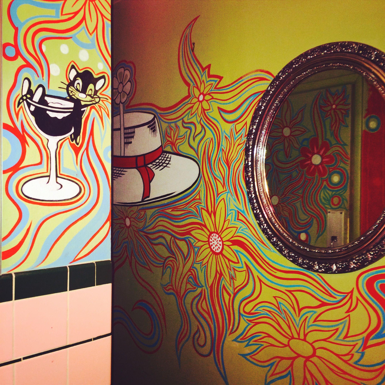 Hattie's Hat in Ballard, WA the oldest bar in Ballard has vibrant fun 70's inspired murals in the ladies restroom. www.thebestplacestopee.com