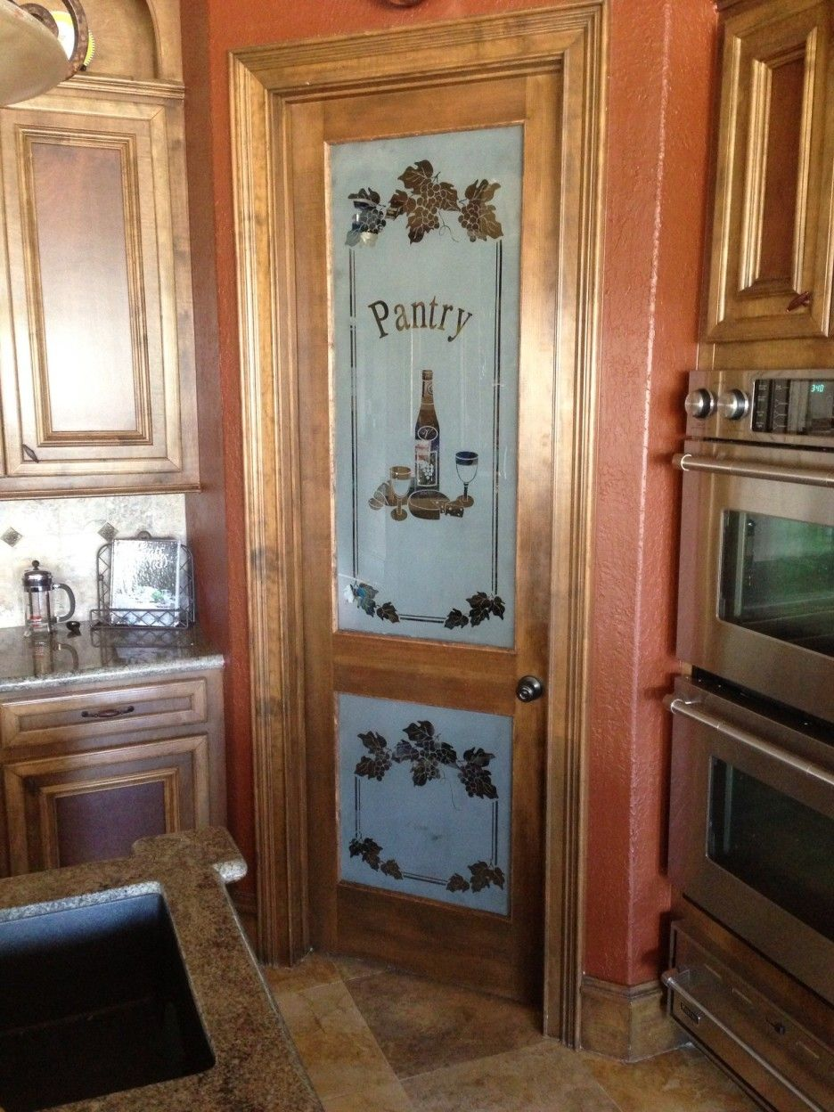 Kitchen. corner pantry cabinets with doors and stained ...