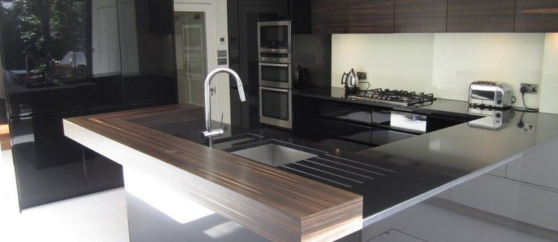 A stylish and sleek designer kitchen from high-end manufacturers ...