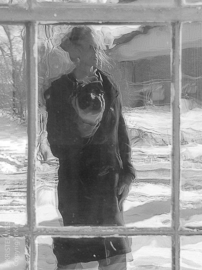 Looking Inside - Day 15 / I captured this self portrait while standing outside, looking in through lead glass windows, which reflected my own image back to me.