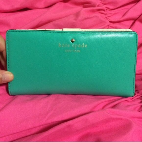Kate Spade clip wallet Like new Kate Spade clip wallet. There are 13 spots to place cards. There are four slots to place your cash (flat). And a back for your coins. However, there is ONE flaw and it is as shown! kate spade Bags Wallets