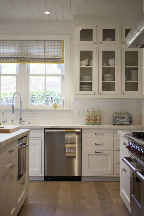 All White Kitchen With Mid Tone Wide Plank Hardwood Floors Glass