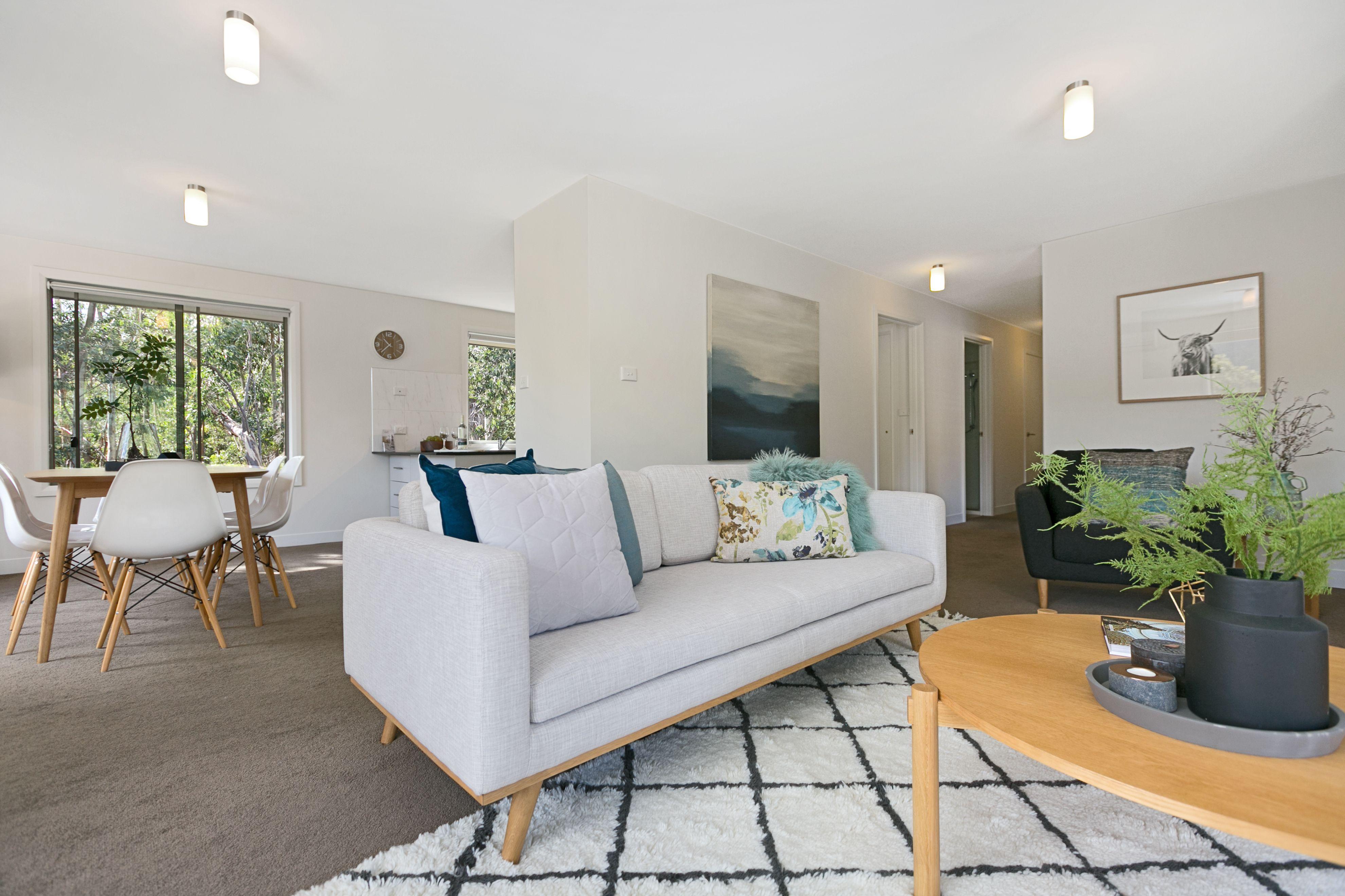 open plan living, cream textural floor rug, timber coffee table ...