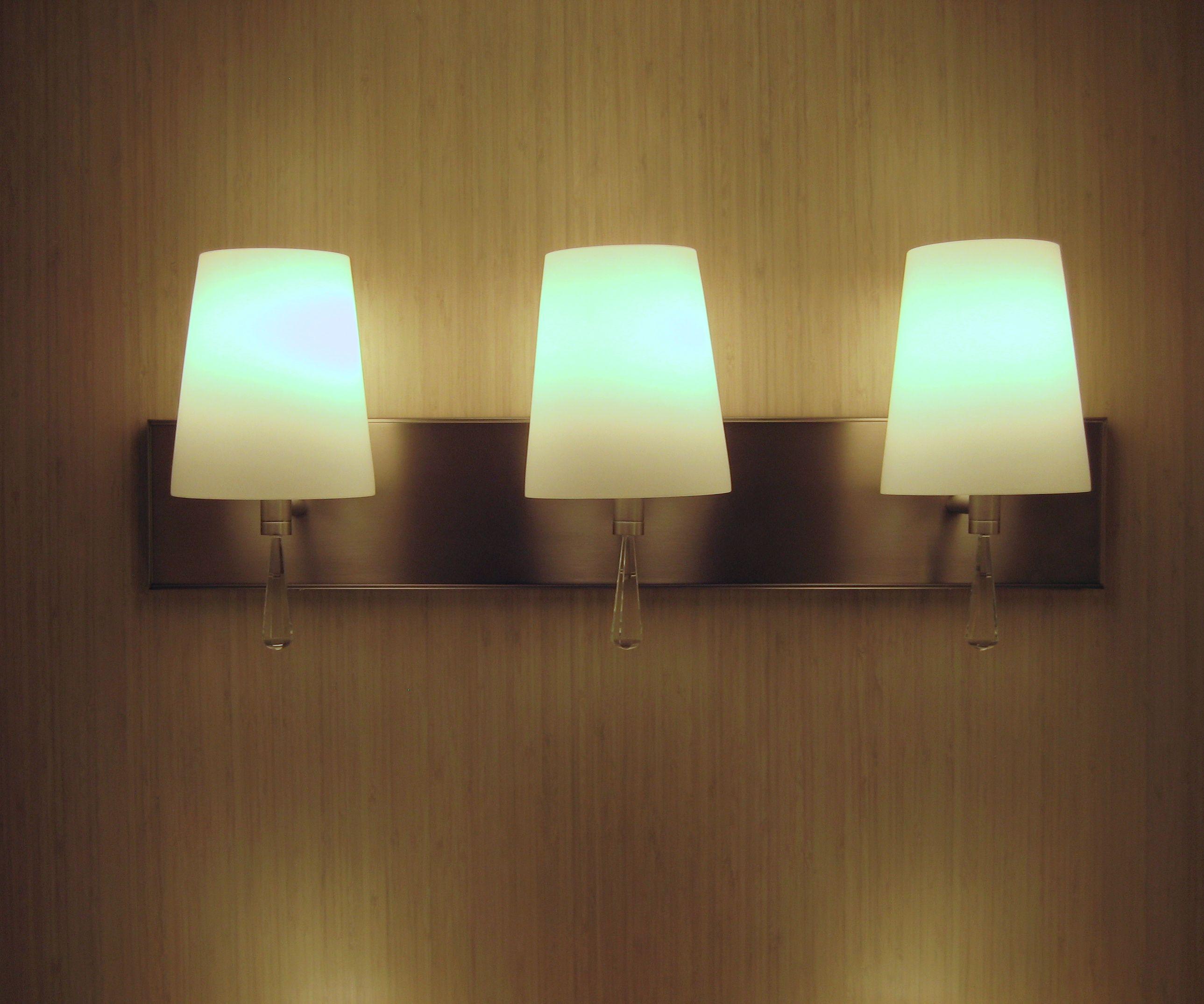 monica collection, elegant vanity light, feiss. | dallas market