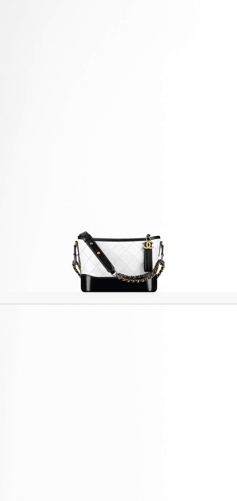 CHANEL'sGABRIELLE small hobo bag, aged calfskin, smooth calfskin, silver-tone & gold-tone metal-beige & black - CHANEL