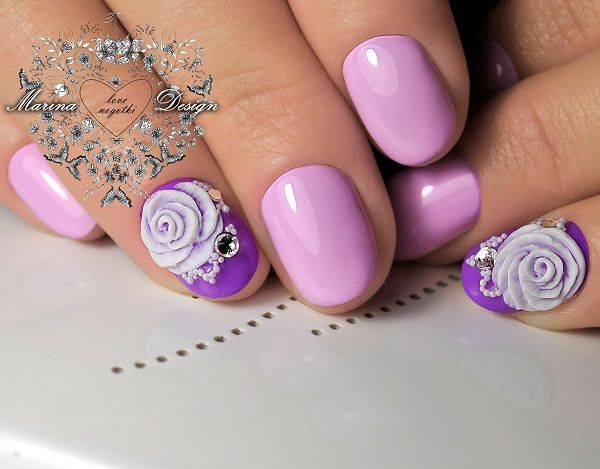 Beautiful pink themed rose nail art design. The nails are painted in thistle pink nail polish with combination of purple colors make a wonderful soft and feminine effect.