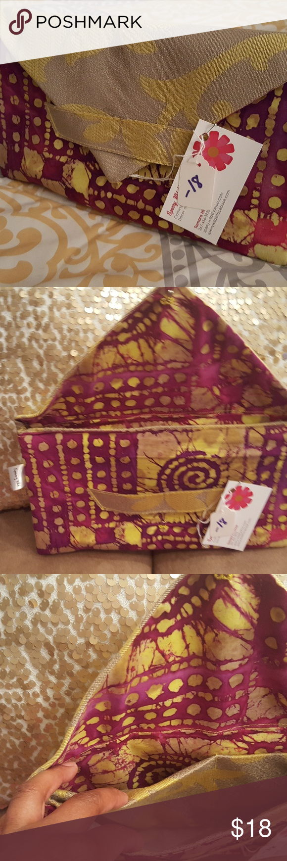 Stylish African and flower print clutch Clutch is made with Cotton african print fabric and mixed with yellow flower print which is adorable. Closes in the front can be carried through handle on front. 3 inside pockets for phone and money, credit cards. Great for Mother's day.  Made by me. New never used. Bags Clutches & Wristlets