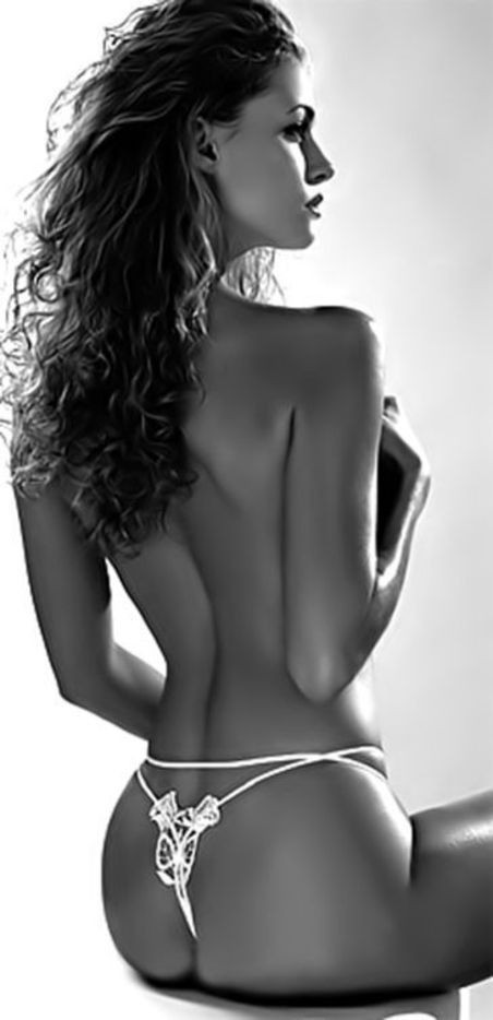 Erotic, Side shot, breast concealed, slender waist with ornate string  thong, beautiful buttocks, tastefully done nude art form.