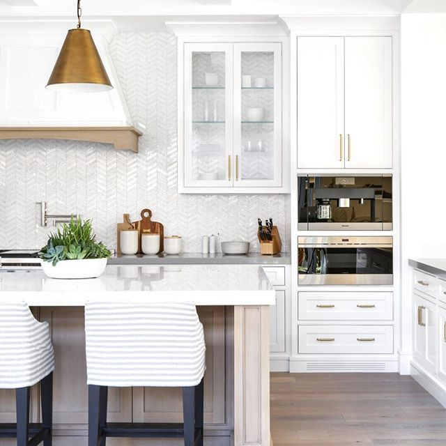 A Modern Bright And Airy Kitchen With Wooden Details