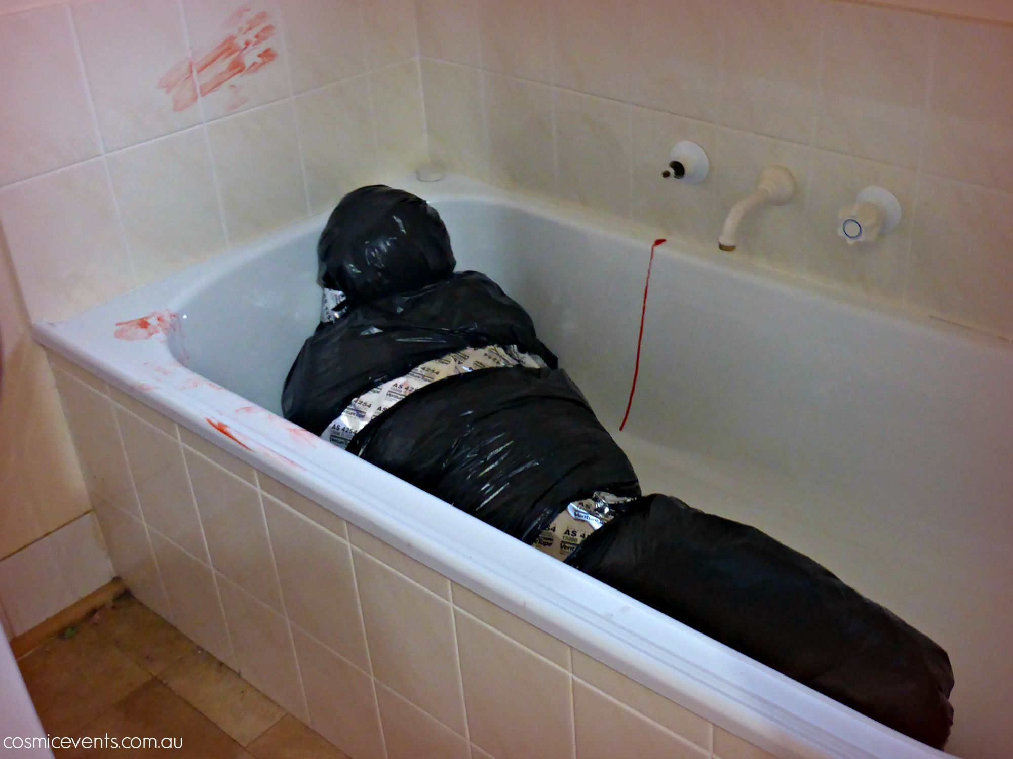 Body in the bathtub. Made from scrunched up newspaper, plastic bags ...