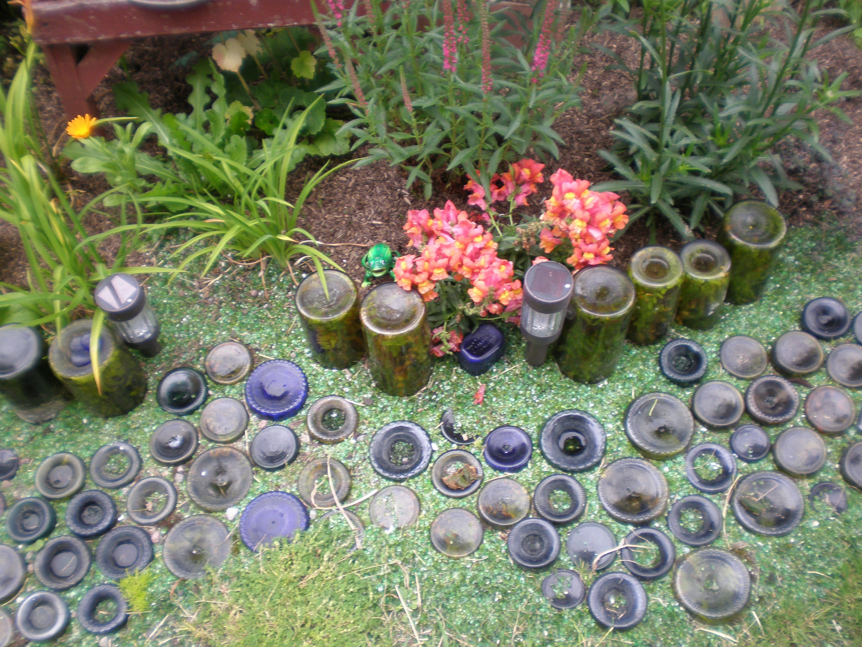 Refunction wine bottles as a garden path and border this for How to use wine bottles in the garden
