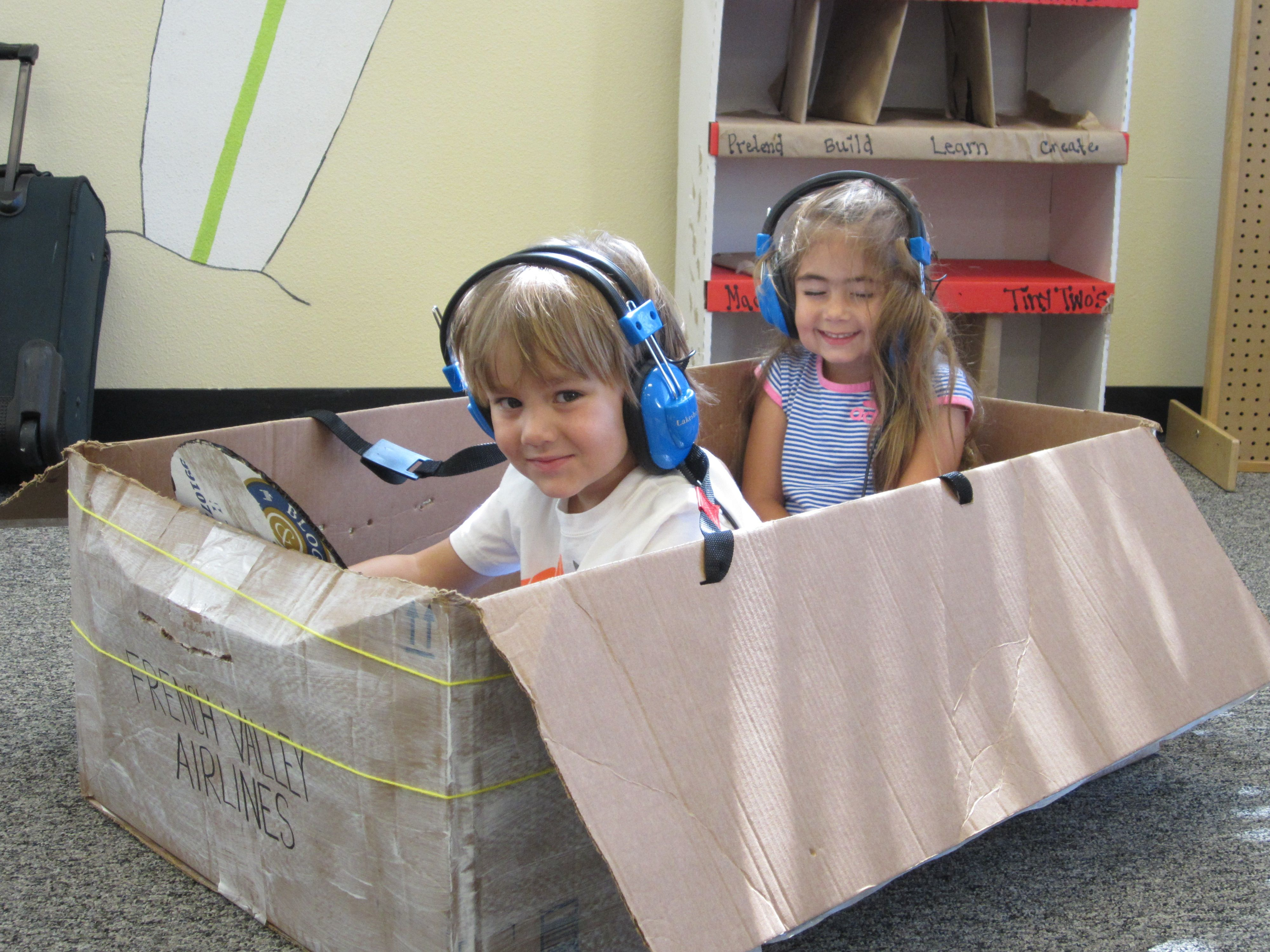 A Cardboard Box And Headphones From The Listening Center