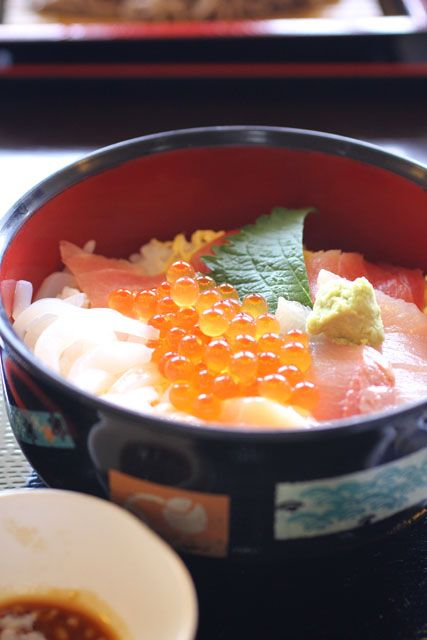 bowl of rice with fresh sea foods