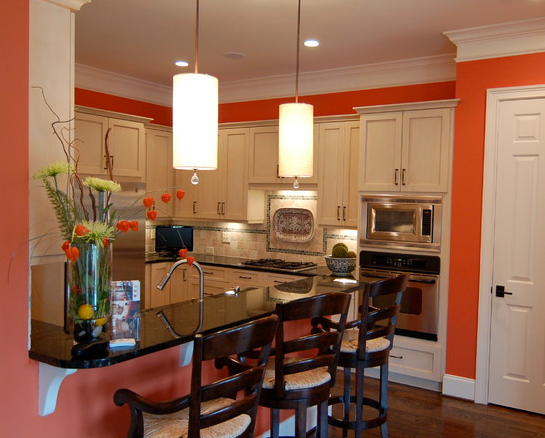 Orange kitchen walls bold colored kitchen walls accent for Dark orange kitchen