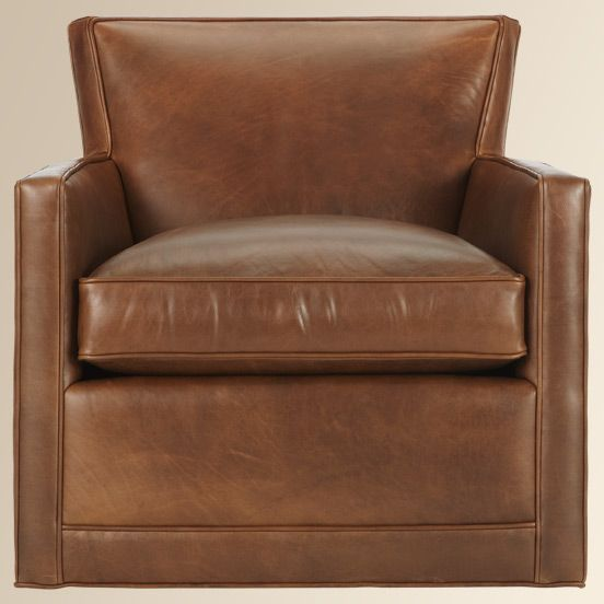 Rudy Swivel Leather Chair In Front Of Fireplace Lake House