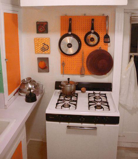 diy hanging pegboard kitchen pot pan utensil holder how to on wwwdearhandmadelife - Kitchen Pegboard Ideas