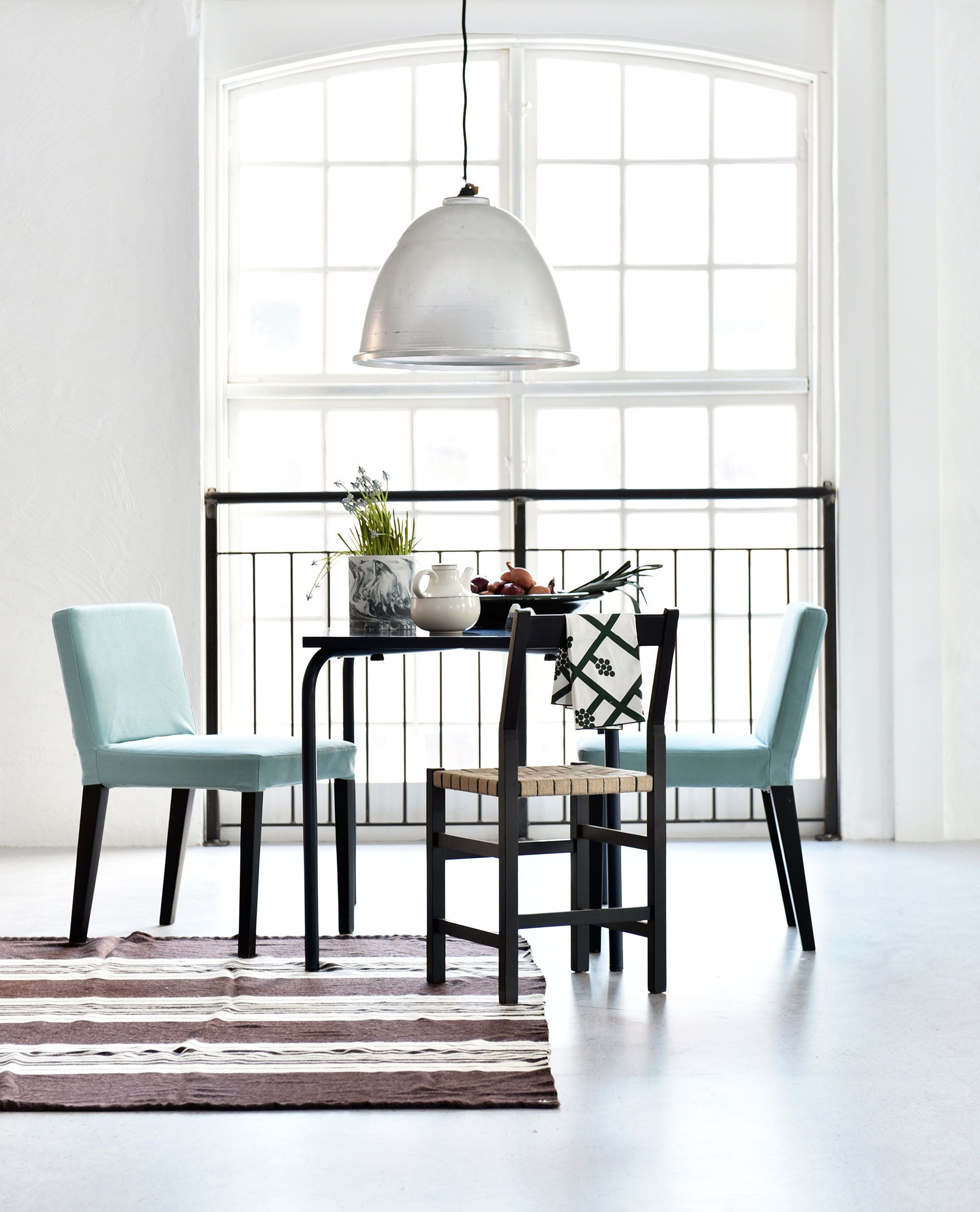 Industrial Loft Vibes With Huge Arched Windows Black Kitchen Table