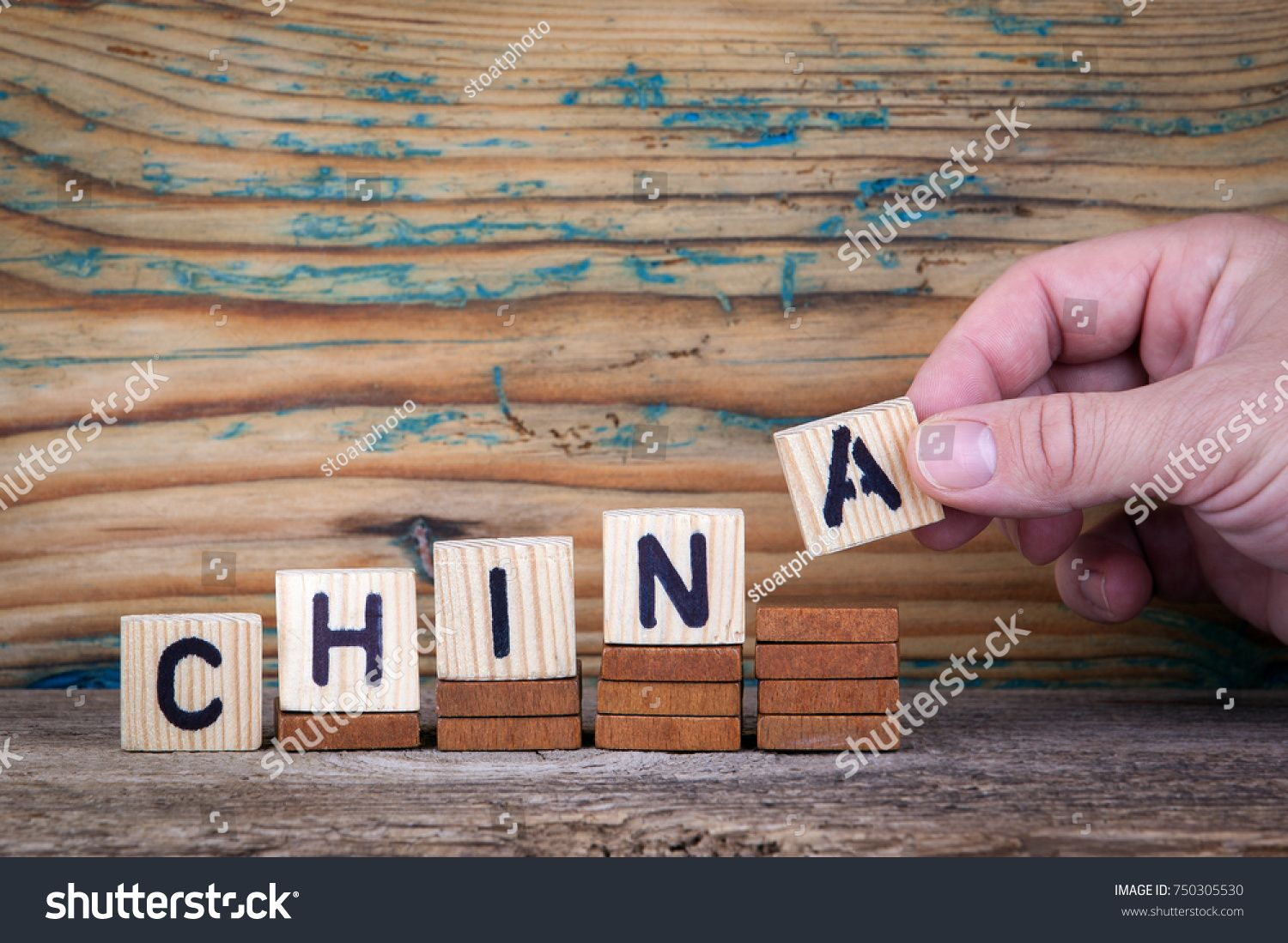 china. Wooden letters on the office desk, informative and communication background